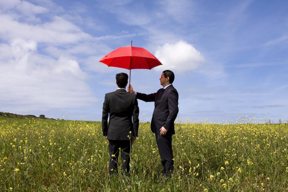business man holding umbrella Wintson-Salem NC