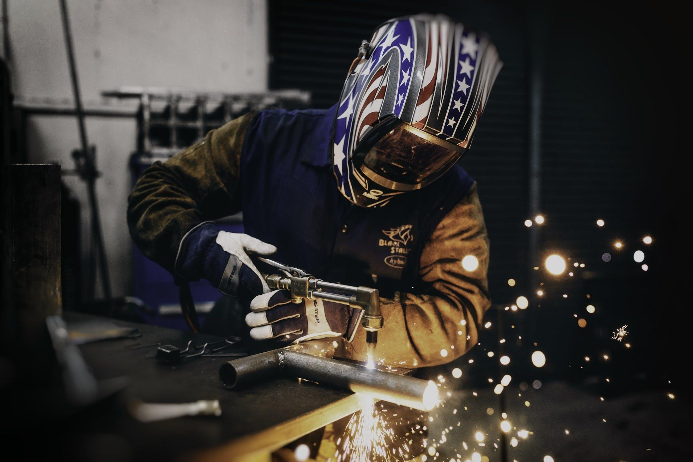 Man welding.