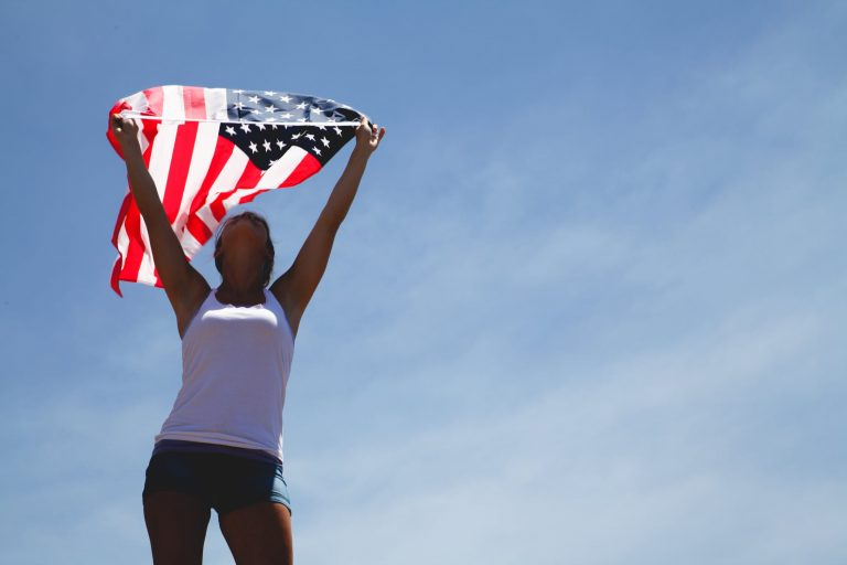 Woman holding American flag.