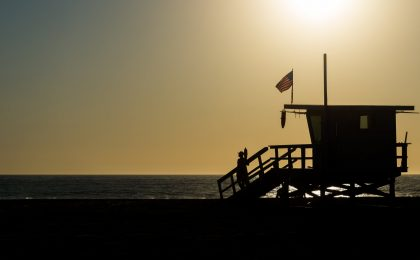Flag waving on lifeguard stand in California.