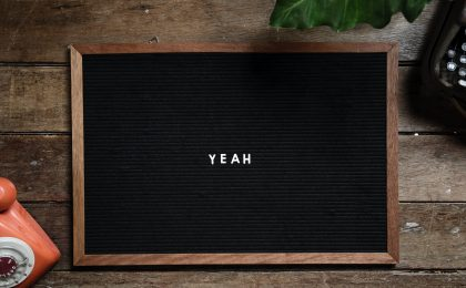 "The word ""Yeah"" on a blackboard."