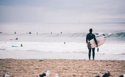 Surfer looking at waves.