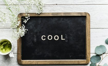 "The word ""cool"" on a black board."