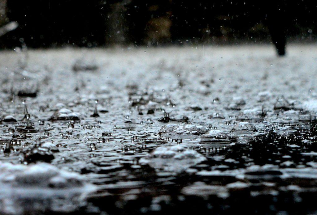 Rain falling during flood.