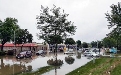 Cars and homes in a flood without flood insurance.