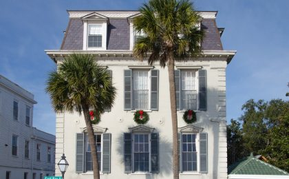 Palm tree in front of a lovely Charleston home.