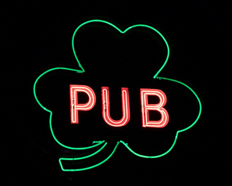 Neon shamrock sign that reads: Pub.