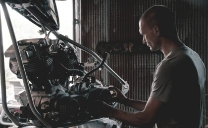 Mechanic working on engine.