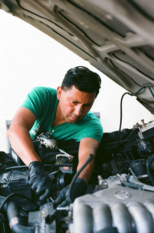 Man working on car.