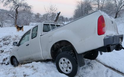 Truck wrecked in a snow bank.