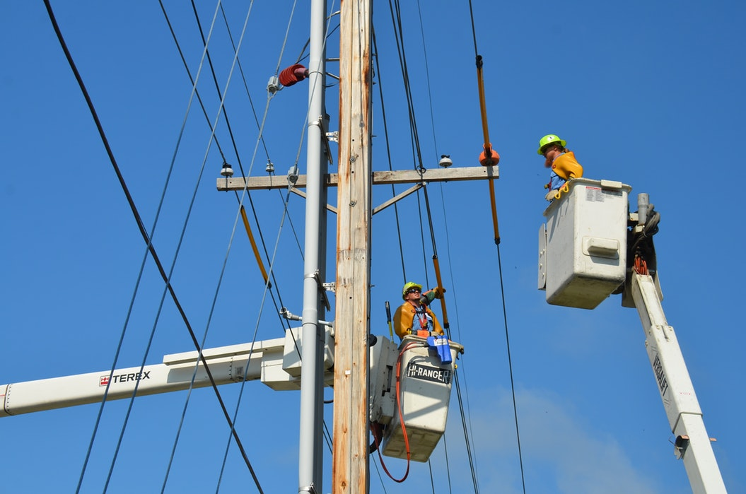 Electrical workers on power lines.
