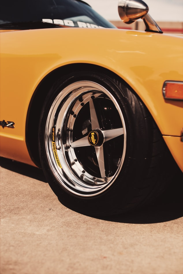 Tire on yellow car.