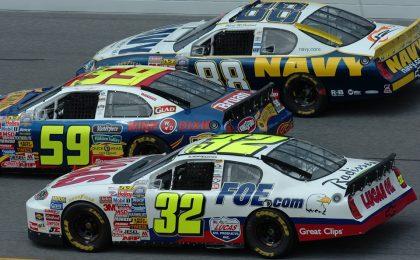 NASCAR cars close together.