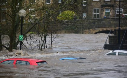 Cars under flood waters.