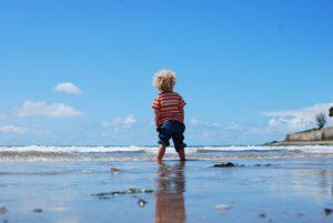 Baby on beach.