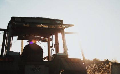 Farmer on tractor.