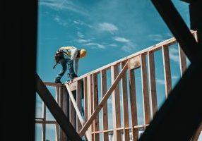 Man building house.