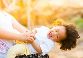 woman-holding-baby-smiling-1116050